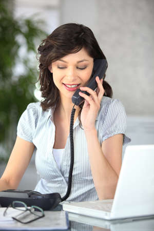clerical: Female receptionist Stock Photo