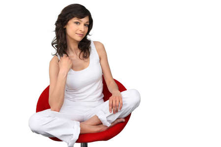 easy chair: woman sitting in a red chair