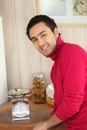 largesse: young man in a kitchen