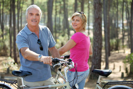 50 to 55 years: Couple out on a bike ride