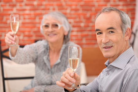 Senior couple having a dinner in a restaurant photo