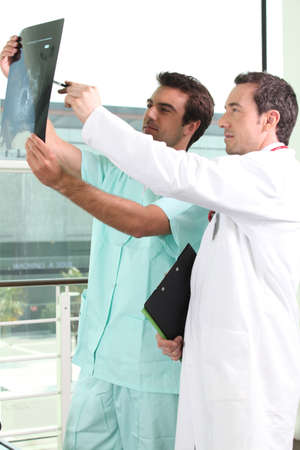 Two male doctors looking an x-ray image Stock Photo - 12248190