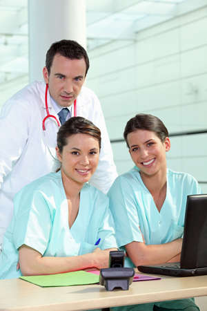 nursing young: Physician and female nurses