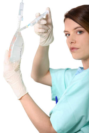 gloves nurse: Female administering drugs Stock Photo