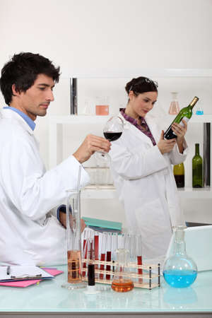 oenologists working in a lab photo