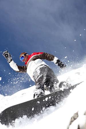 powder snow: Snowboarder spraying powder