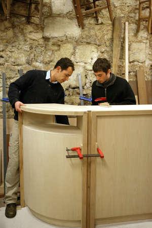 Carpenters building a bar Stock Photo - 12251874