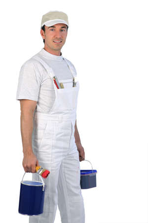 decorator: Male painter carrying paint pots Stock Photo