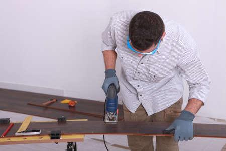 tradesperson: Man operating a jigsaw