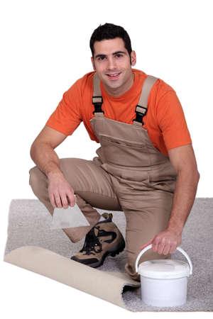 yourselfer: handyman laying wall-to-wall carpet