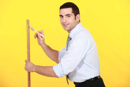 Office worker painting wood photo