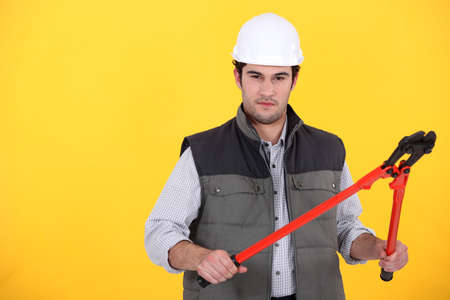 A male construction worker with pliers. photo
