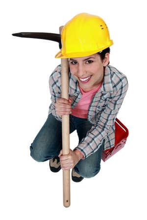 workwoman: High-angle shot of a tradeswoman holding a pickaxe Stock Photo