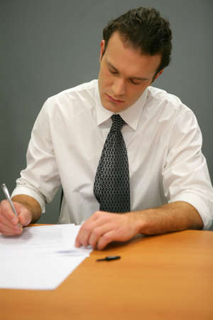 Businessman writing photo