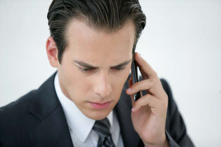 A concerned businessman talking on his mobile phone Stock Photo - 12250803