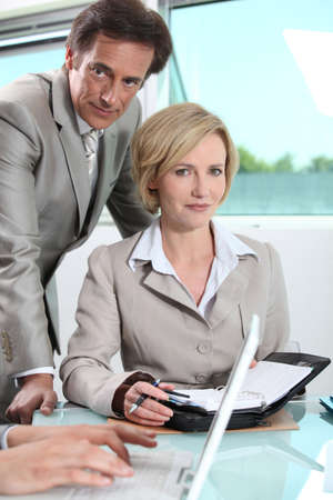 Executives making a date in diary Stock Photo - 12251798