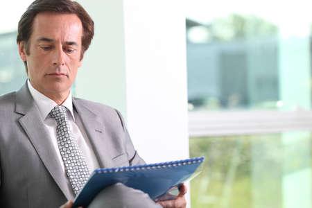 Businessman reading notes. Stock Photo - 12251307