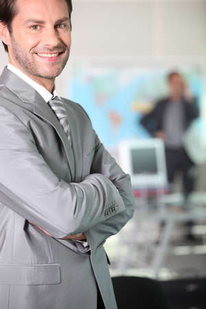 30 to 40: Smiling executive
