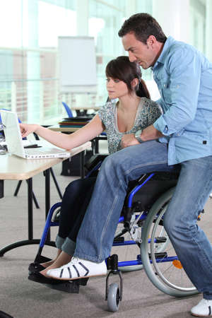 Girl working in a wheelchair photo