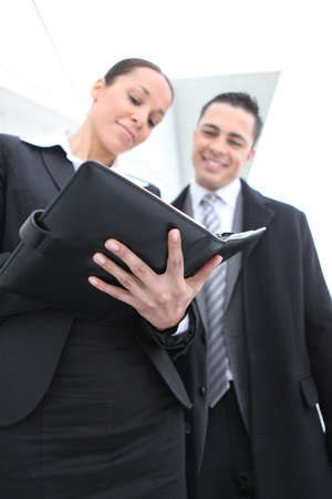 half dressed: Woman using a personal organizer