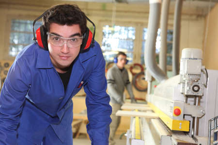 factory worker: apprentice working in a factory