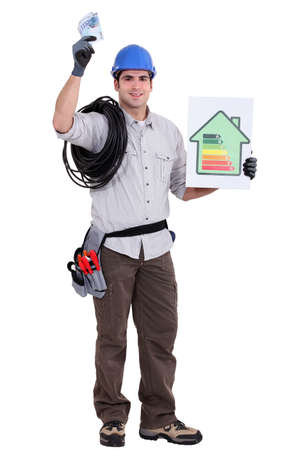 craftsman holding an energy consumption label and money in cash Stock Photo - 12250777