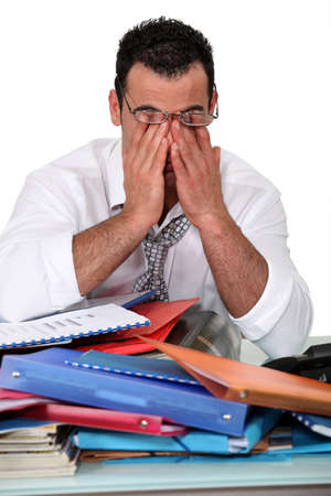 over burdened: Office worker working overtime
