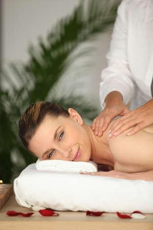 destress: Woman enjoying a back massage Stock Photo