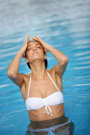 wet bikini: Woman going for a refreshing swim Stock Photo