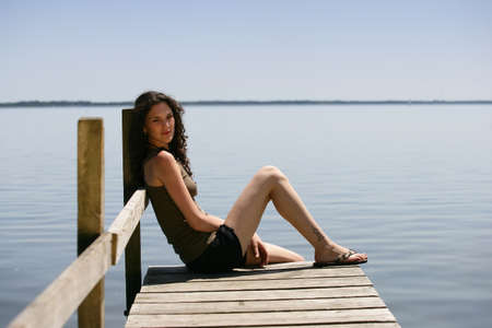 long lake: Woman sat on jetty