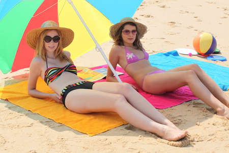 Girls lying on the beach photo