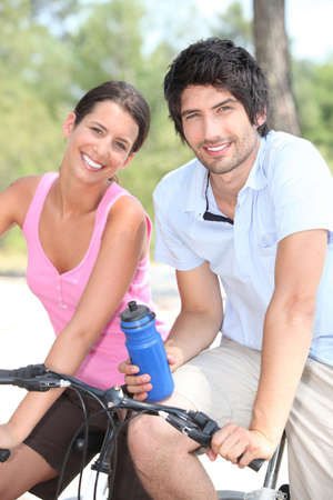Couple cycling together photo