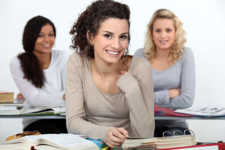 University students at desks photo