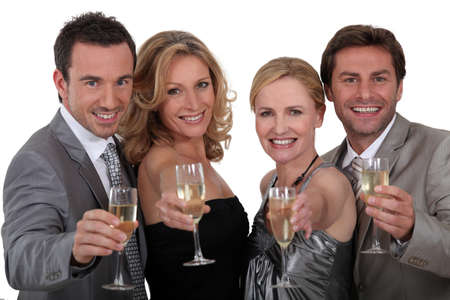 Four people toasting success photo