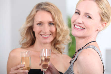 Two women with champagne flutes photo