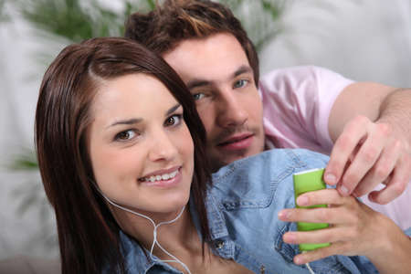 young couple listening music photo