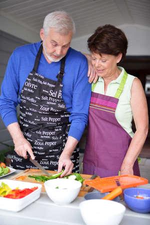 Mature couple in kitchen photo