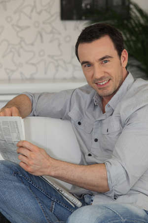Man reading the newspaper at home Stock Photo - 12251939