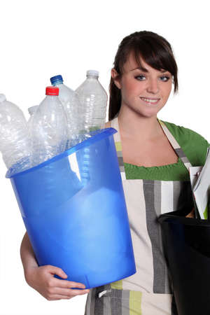 Teenager taking out the recycling photo