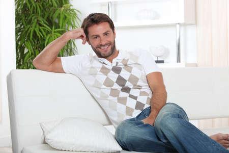 unwinding: Man relaxing at home