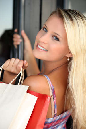 Blond teenager with shopping bags photo