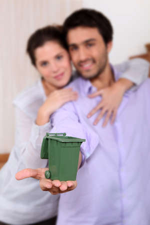 reprocess: Couple holding miniature bin Stock Photo