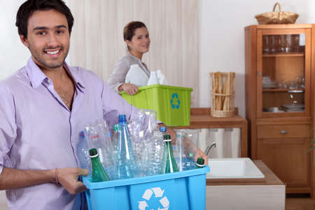couple doing recycling photo
