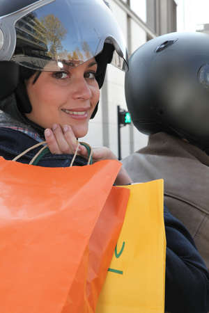 Young couple with shopping bags on a moped photo