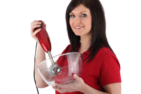 Woman with an electric mixer photo