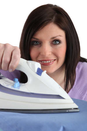 maneuverable: Brunette woman with iron