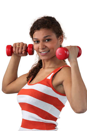 young woman lifting dumbbells photo