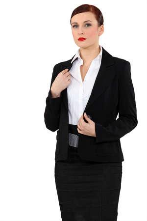 authoritative woman: portrait of beauteous businesswoman