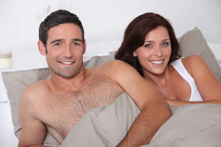 Happy couple in bed Stock Photo - 12251895