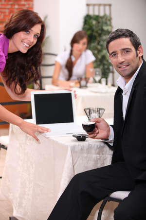 proprietor: Couple looking at a blank computer screen in a restaurant